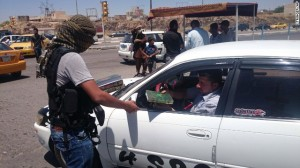 isis terrorist hands out quran in mosul